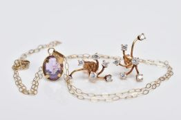 AN AMETHYST PENDANT NECKLACE AND A PAIR OF EARRINGS, the pendant designed with an oval cut
