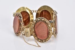 A YELLOW METAL GOLD STONE BRACELET, designed with five large oval links, each set with an oval panel