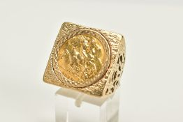 A 9CT GOLD HALF SOVEREIGN RING, the half sovereign dated 1910, set within a textured square