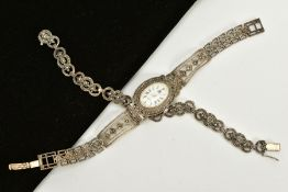 A LADIES SILVER MARCASITE WATCH AND BRACELET, the watch of oval design, white dial, Roman