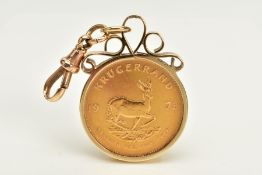 A 1973 KRUGERRAND IN A YELLOW METAL MOUNT, within a yellow metal collet mount of scroll design,