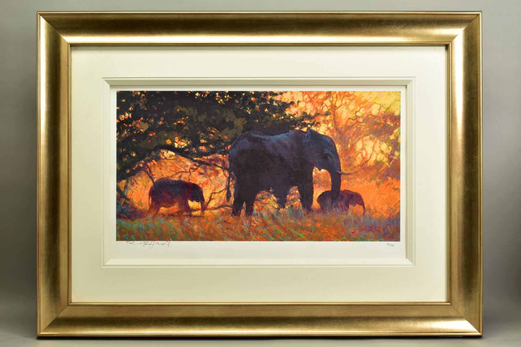 ROLF HARRIS (AUSTRALIAN 1930), 'Backlit Gold', a Limited Edition print of Indian Elephants, 83/