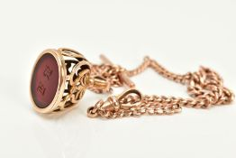 A ROSE GOLD ALBERT CHAIN WITH CARNELIAN INTAGLIO FOB, the yellow metal fob of oval design, set