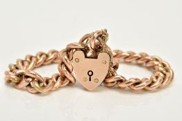 A YELLOW METAL CHARM BRACELET, the hollow curb link bracelet, each link stamped 9c, approximate