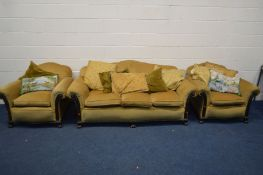 A LATE 19TH/EARLY 20TH CENTURY MAHOGANY FRAMED THREE PIECE LOUNGE SUITE, with mustard coloured