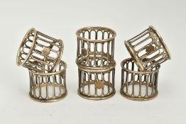 A SET OF SIX SILVER OPENWORK NAPKIN RINGS, each designed with openwork columns and a vacant shield