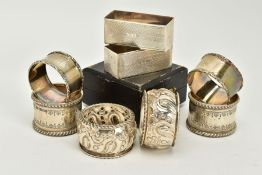FOUR SETS OF TWO SILVER NAPKIN RINGS, to include a pair of plain polished foliate edge detailed