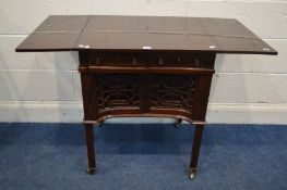 A MAHOGANY SOFA TABLE, with two drawers, double cupboard doors, above fretwork panels, on brass
