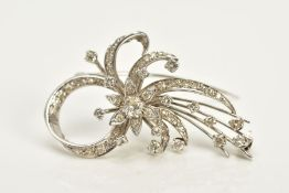 A WHITE METAL FLORAL DIAMOND BROOCH, of openwork floral and foliate design, set with round brilliant