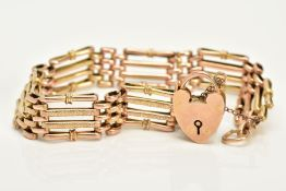 A YELLOW METAL GATE BRACELET, each link with four bars two plain polished and two textured stamped