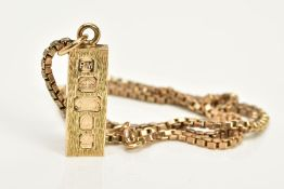 A 9CT GOLD INGOT AND CHAIN, the textured front ingot pendant, hallmarked 9ct gold London 1977,