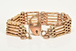 A WIDE YELLOW METAL GATE BRACELET, each link with five plain polished bars, stamped 9ct, approximate
