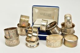 A QUANTITY OF SILVER NAPKIN RINGS, to include thirteen rings of various designs, all with