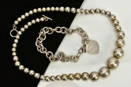 A WHITE METAL BALL NECKLACE AND CHARM BRACELET, the necklace designed as plain polished graduated