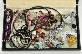 A SELECTION OF COSTUME JEWELLERY, to include two white metal charm bracelets with charms, a pink