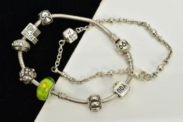 A PANDORA CHARM BRACELET WITH CHARMS AND ONE OTHER, the snake chain bracelet fitted with seven