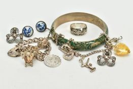 A SELECTION OF JEWELLERY, to include a silver charm bracelet, suspending four white metal charms
