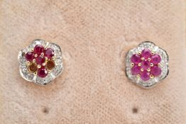 A PAIR OF 9CT GOLD RUBY AND DIAMOND EARRINGS, each of a flower design set with circular cut