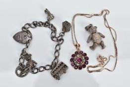 A SMALL QUANTITY OF JEWELLERY, to include a gold plated flower pendant necklace set with circular