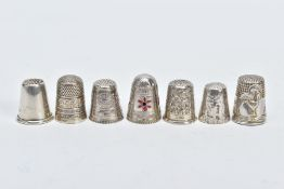 SEVEN THIMBLES, to include a plain polished thimble, hallmarked Birmingham, a floral engraved