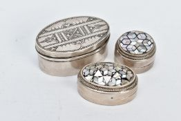 TWO EGYPTIAN SILVER PILL BOXES AND A WHITE METAL TRINKET BOX, two pill boxes of a circular and