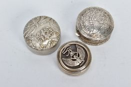 TWO EGYPTIAN SILVER PILL BOXES AND ONE OTHER, the first with an openwork figure of 'Iris' the