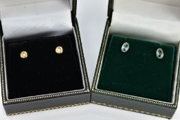 TWO PAIRS OF 9CT GOLD GEM SET EARRINGS, the first pair each designed with a round brilliant cut