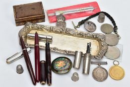 A SELECTION OF ITEMS, to include a silver candle snuffing tray, with an engraved monogram to the