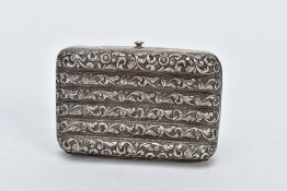 A WHITE METAL ORNATE CASE, of a floral and foliate embossed design, fitted with a push button clasp,