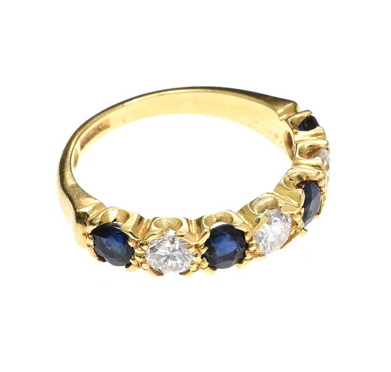 Lot 405 - 18CT GOLD SAPPHIRE AND DIAMOND ETERNITY RING