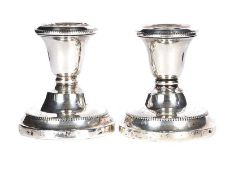 PAIR OF SILVER DWARF CANDLESTICKS