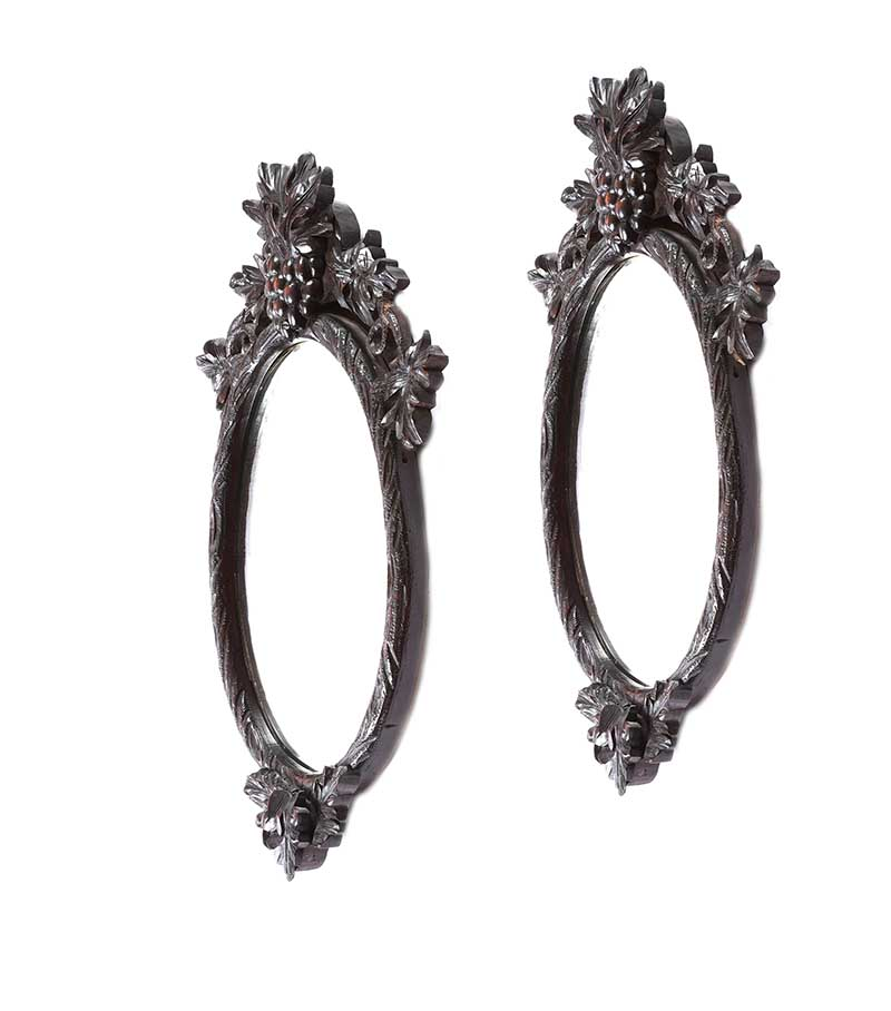Lot 31 - PAIR OF VICTORIAN BLACK FOREST OVAL MIRRORS