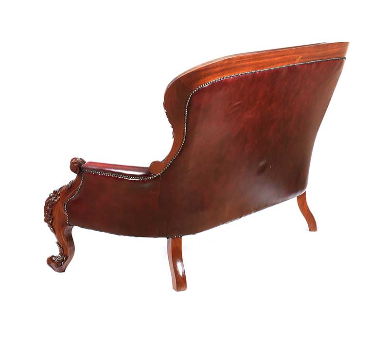 Lot 10 - DEEP BUTTONED LEATHER SETTEE