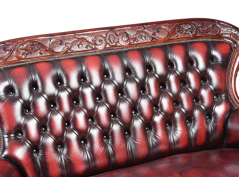 Lot 16 - DEEP BUTTONED LEATHER SETTEE