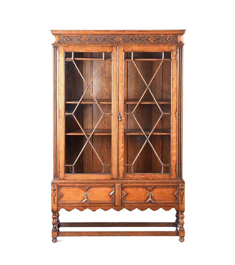 Lot 19 - ANTIQUE OAK TWO DOOR BOOKCASE