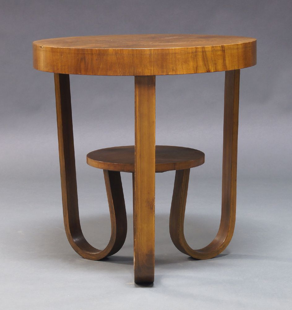 Lot 1172 - An Art Deco walnut two tier occasional table, c.1930, the circular quarter veneered top on curved