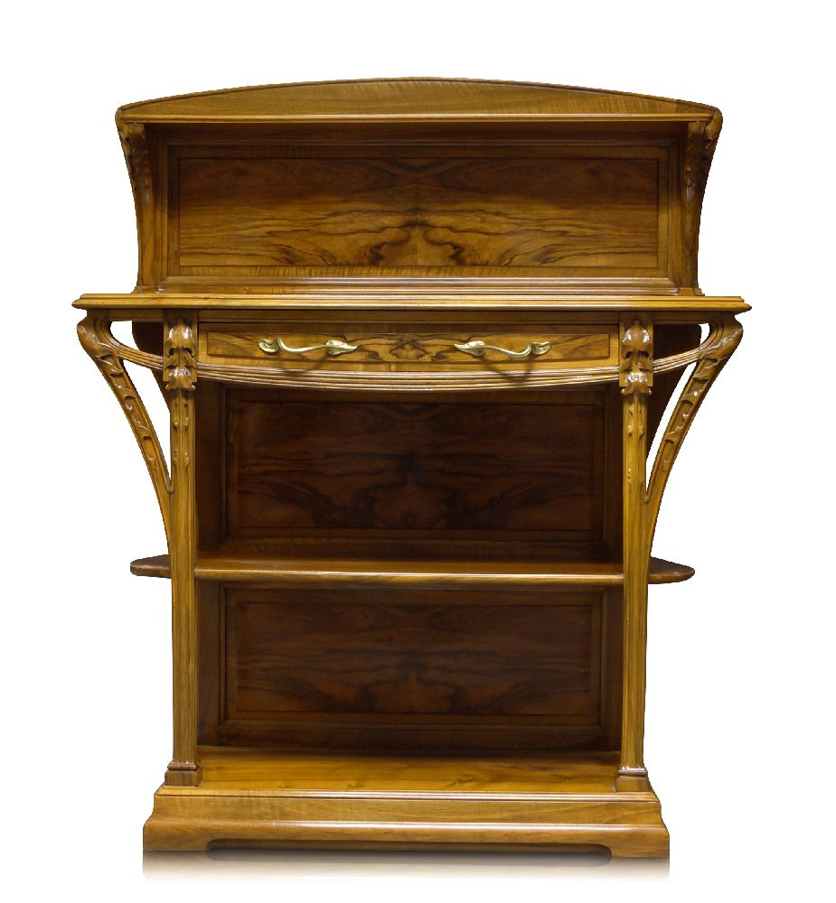 Lot 59 - Louis Majorelle (1859-1926), an Art Nouveau small carved walnut buffet c.1900 Panelled back with