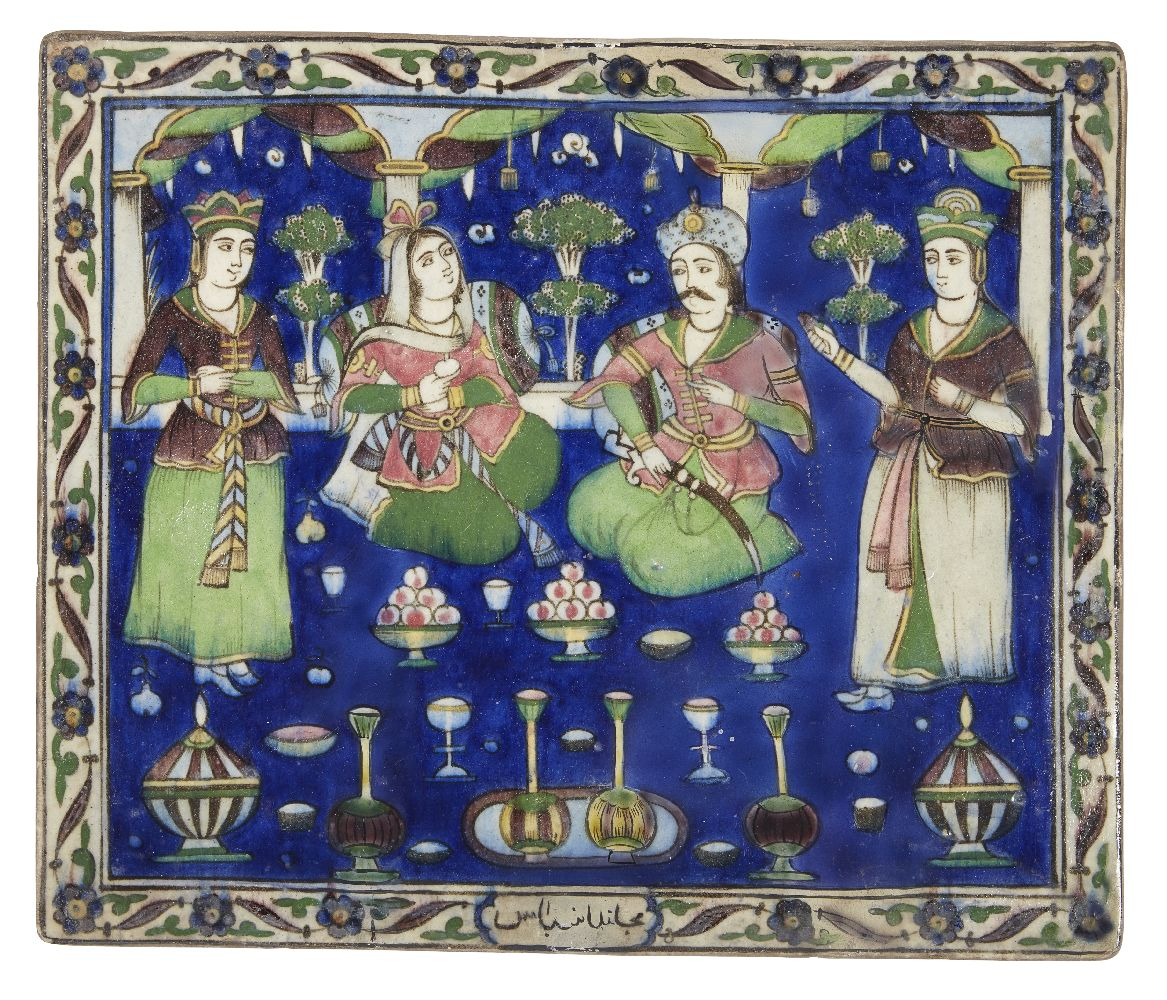 Lot 241 - A Qajar moulded pottery tile with a wedding feast scene, Iran, 19th century, of rectangular form,