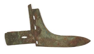 A Chinese bronze halberd blade, Han dynasty, sparsely covered with malachite-green encrustations,