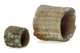 A Chinese bronze bracelet and ring, each with studded decoration, 4.5cm and 2.5cm diameter (2)