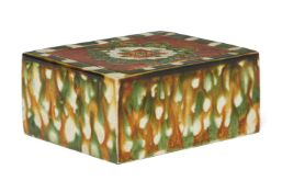 A Chinese sancai-glazed pottery pillow, Tang dynasty, the top and underside decorated with an