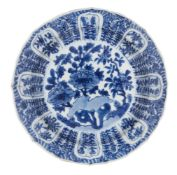 A Chinese porcelain dish, Kangxi period, painted in underglaze blue with flowering peony blooms to