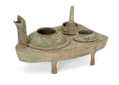 A Chinese bronze zoomorphic stove, Han dynasty, modelled as a stylised turtle, with head forming the