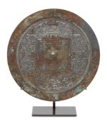 A large Chinese silvered bronze 'TLV' mirror, Western Han dynasty, finely cast with the 'Four