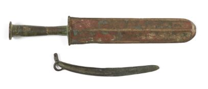 Two Chinese bronze knives, Warring States period and later, one with double-edged rounded blade,