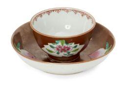 A Chinese porcelain sparrow-beak milk jug and a Batvian Ware cup and saucer, Qianlong period, each