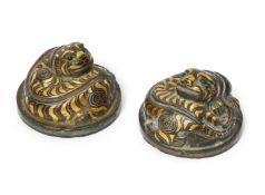 A rare pair of Chinese bronze and inlaid 'tiger' mat weights, Western Han dynasty, each finely