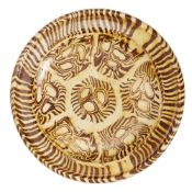 A rare Chinese yellow-glazed marbled pottery tripod dish, Tang dynasty, the white and reddish-