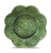 A Chinese green-glazed pottery 'lotus pond' lobed bowl, Liao dynasty, 10th/11th century, moulded