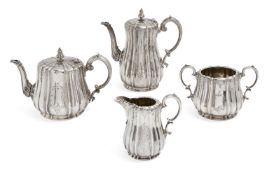 A Victorian four-piece silver tea set, London, c.1863, Edward & John Barnard, of lobed,